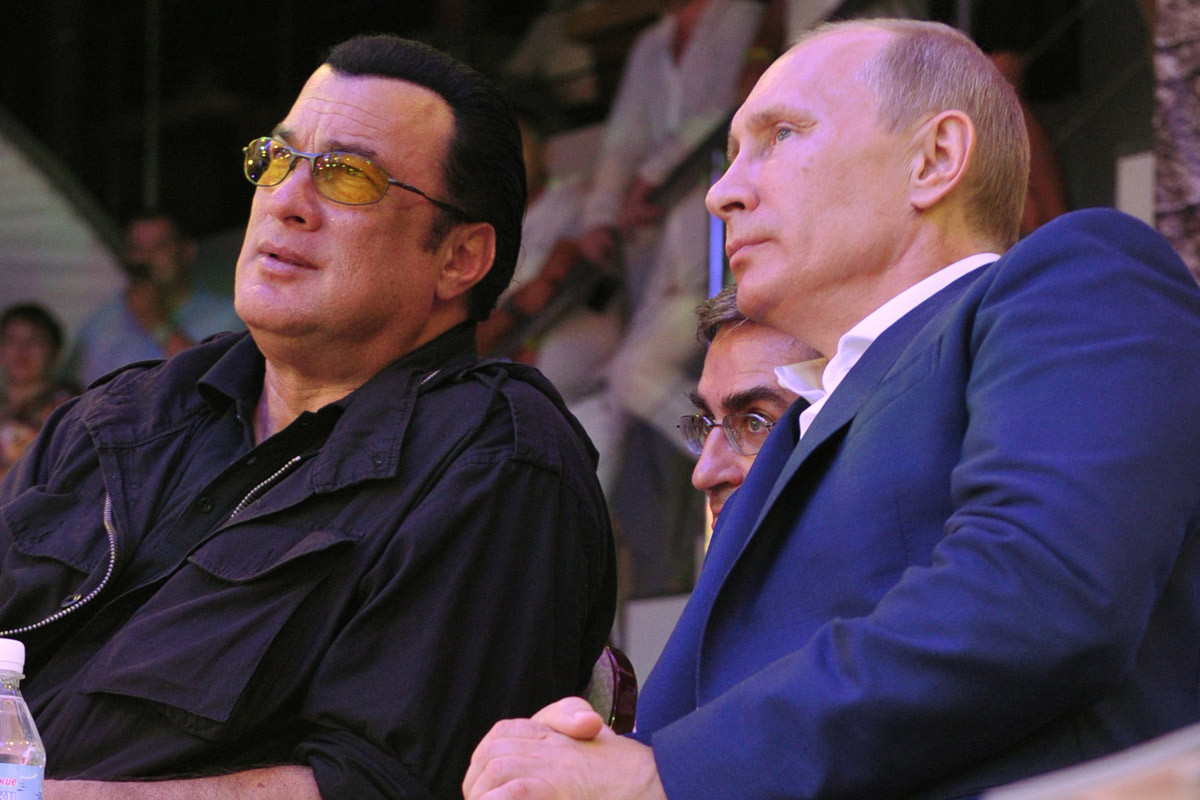 Russian President Putin and U.S. actor Seagal watch the first Russian national championship of mixed martial arts in Sochi