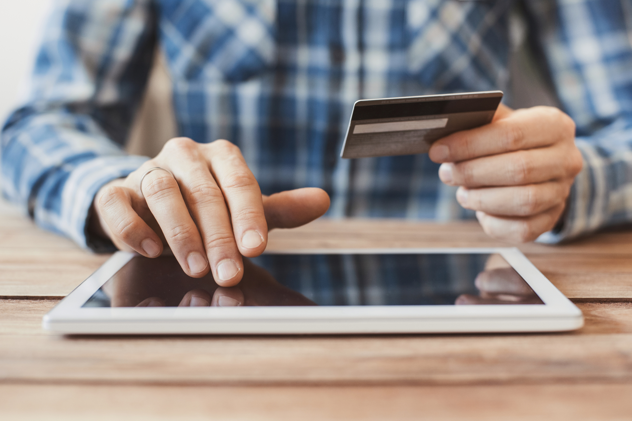 Man shopping online with digital tablet and credit card