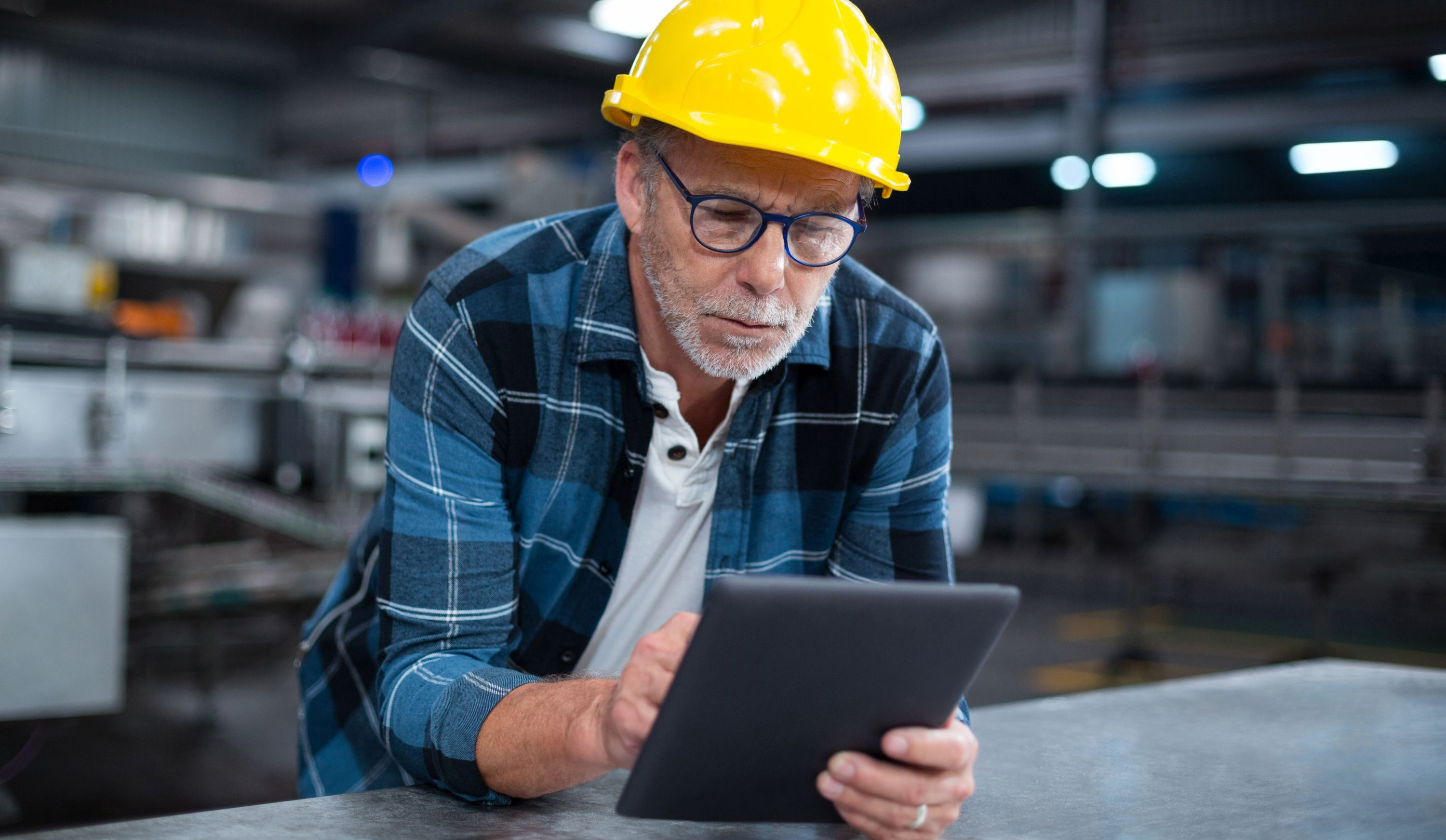 Factory worker using a digital tablet in factory